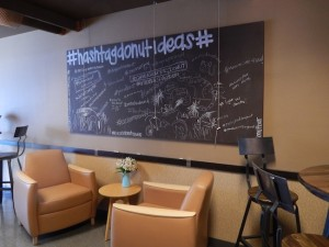 The new lounge has ample seating and chalkboards for donut suggestions and comments. (Photo by Anna Frost)