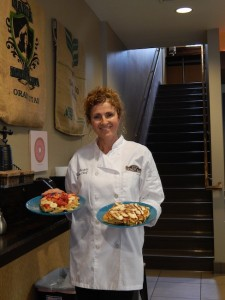 Co-owner Wendy Bartels shares some of their new waffle options. Visible behind her, the staircase to the new upstairs lounge. (Photo by Anna Frost)