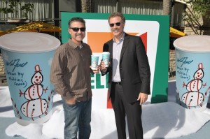 (l-r) Cancer for College founder Craig Pollard with Will Ferrell at the launch of a 7-Eleven cup holiday coffee cup designed by Ferrell and his son Mattias. The cup raised over $350K for the charity. (Photo by John Shearer/Invision for 7-Eleven/AP Images)