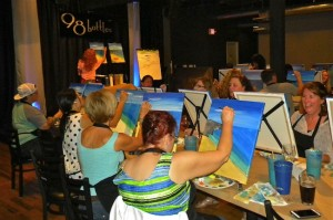 Avid participants at 98 Bottle in Little Italy enjoy a night out with Painting and Vino. (Courtesy Painting & Vino)