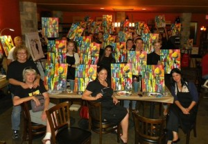 Showing off results at Painting & Vino at Jakes on 6th (Courtesy Painting & Vino)