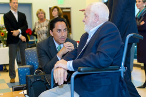 Councilmember Todd Gloria speaking to the late Bud Fischer at a Senior Community Center event. Fischer was a pioneer developer in the Gaslamp Quarter and along with his wife, a huge contributor to SCC. He died in January 2013. (Photo by Arthur Ledford)