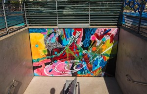 Artwork by Encinitas resident Allison Renshaw was purchased, reproduced in large scale and printed on metal panels in order to greet visitors who emerged from the new underground parking garage. (Courtesy City of San Diego)