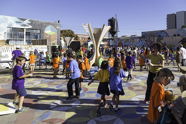 Students enjoy an assortment of activities during Urban Discovery Academy's Oct. 24 groundbreaking ceremony. (Courtesy Aliya Weise)