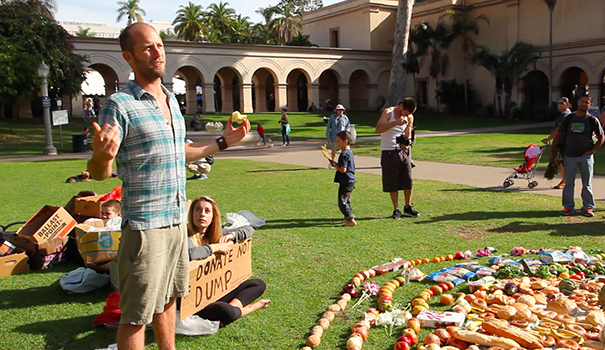 Activist Rob Greenfield with food he retrieved from dumpsters in San Diego at a press conference in Balboa Park. (Courtesy Rob Greenfield)