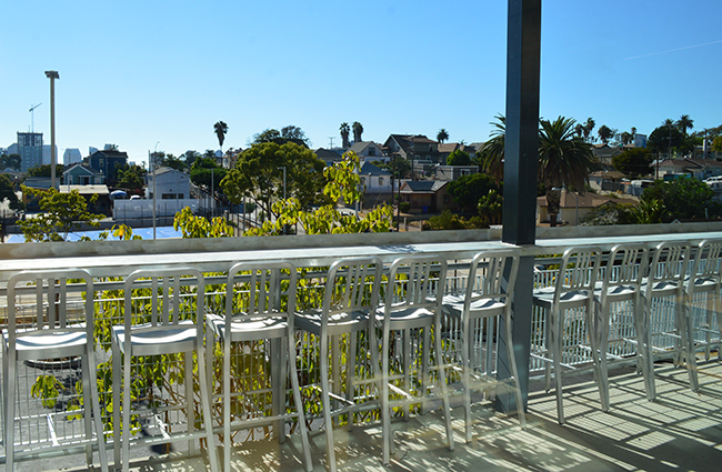 An upper floor lunch balcony overlooks the basketball courts with a view of Downtown  (Courtesy Brad Baquial)