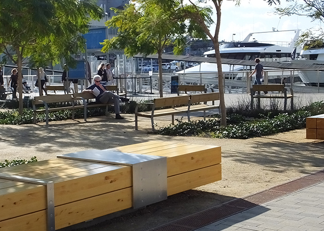 Two types of benches have been deployed to the quiet areas along the Embarcadero for those walking the promenade and needing a moment of reflection (Photo by Delle Willett)