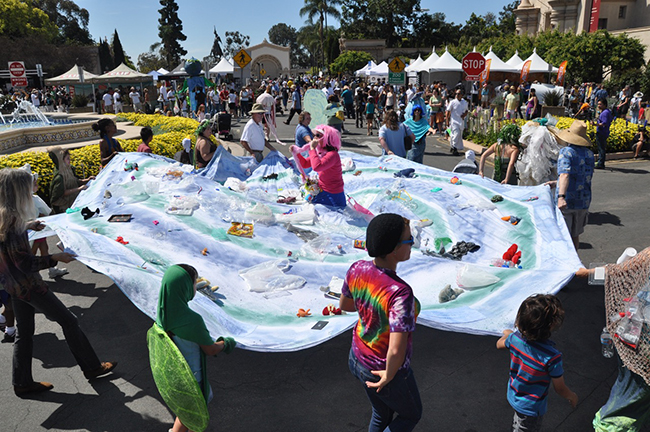 EarthFair 2014 attendees participate in an activity known as the Sea of Plastics demonstrating the dangers of polluting public waterways. (Photo courtesy EarthFair)