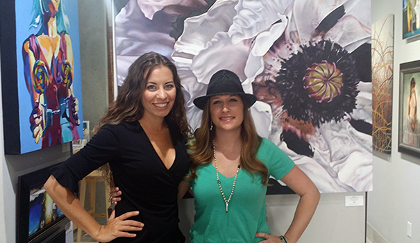 The Adelman sisters in their new gallery, with works by Sarah Streiber (left) and Irina Gretchanaia (Photo by Morgan M. Hurley)