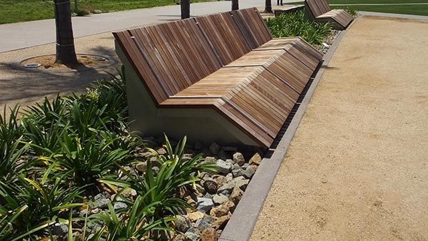 "Custom-designed ""chaise lounge"" benches made of Ipe wood and stainless steel DWweb"