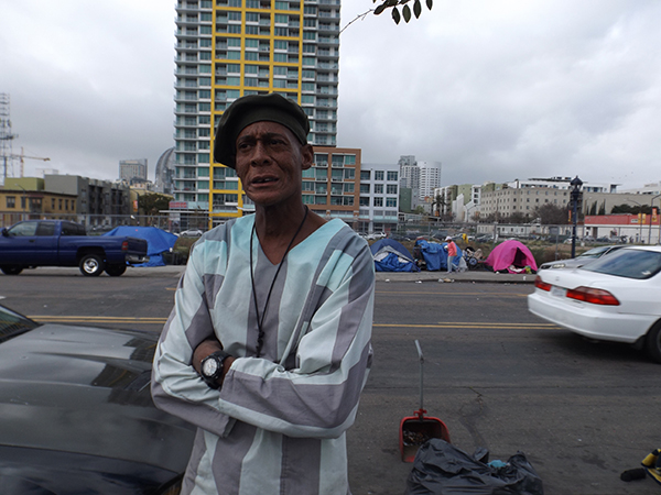 Michael Clark 'Redd' stands where his tiny shelter used to on 16th Street