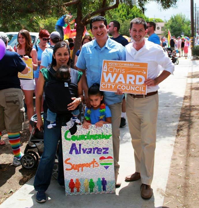 Councilmember Alvarez and his family with Councilmember-elect Ward at Pride.