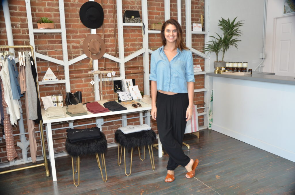 Rachel Hunt in her Wild Dove SD boutique located on Market Street, Downtown (Photo by Diana Cavagnaro)